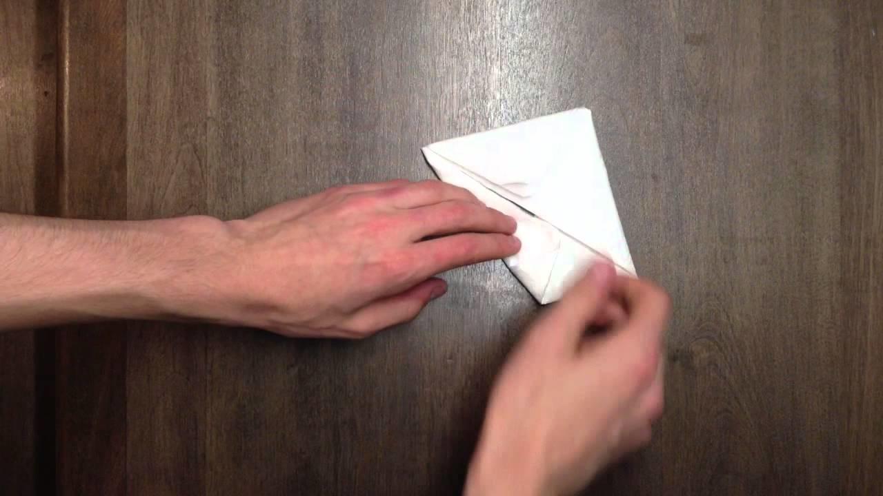 Plier une serviette en forme de lapin - Lapin origami