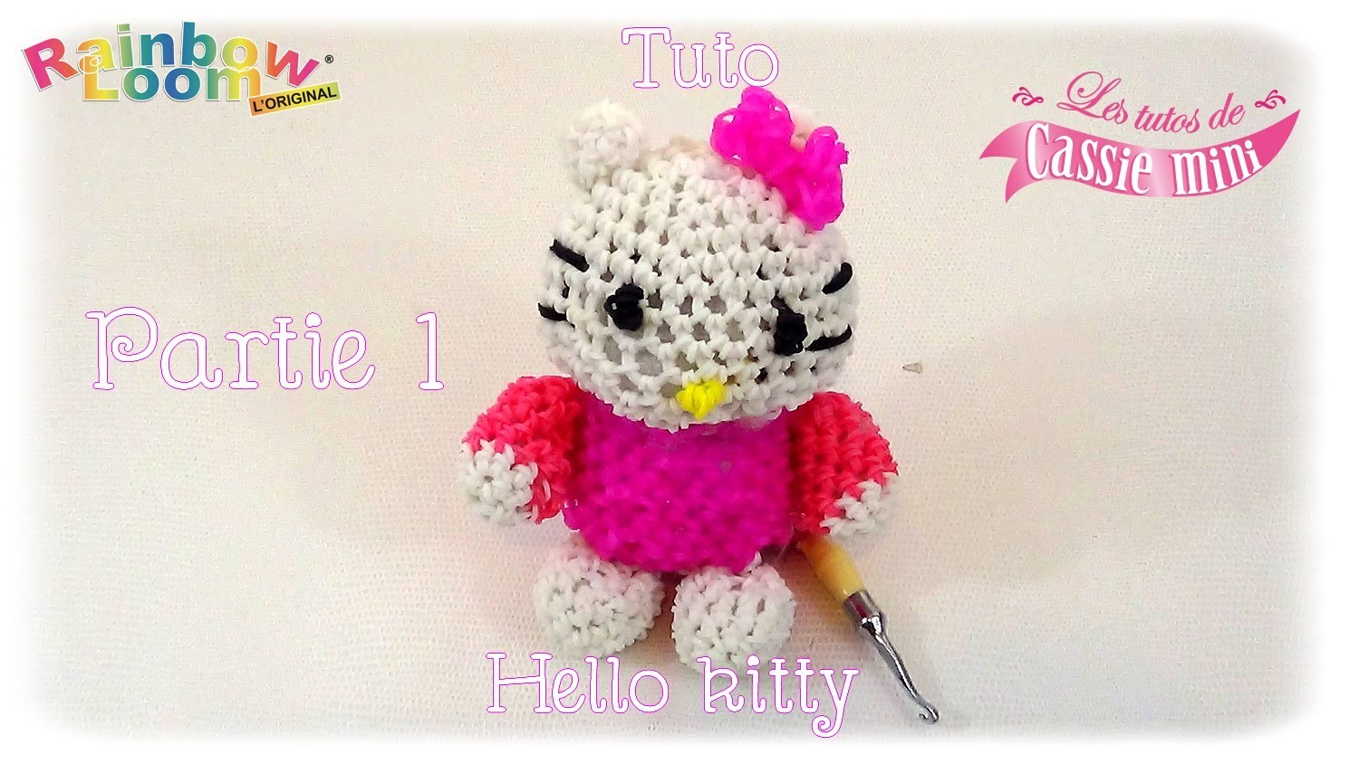 { Tuto } hello kitty  en élastique Rainbow loom partie 1