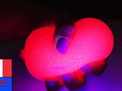 Balle anti-stress avec de la matière visqueuse et peinture qui réagit aux rayon UV