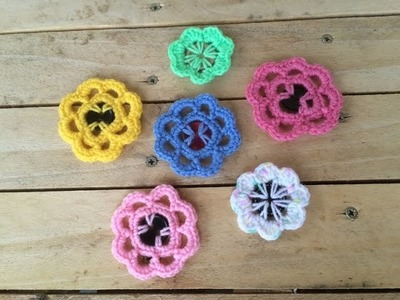 Fleurs au crochet avec boutons. flores a crochet con botones