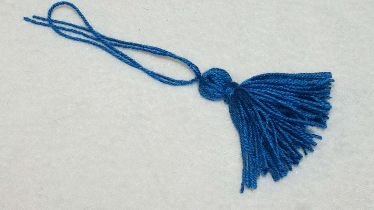 Confectionnez facilement une embrasse pompon décorative. - DIY Arts créatifs - Guidecentral