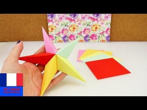 Faire soi-même une étoile en origami. Idée DIY de décoration pour Noël. Pliage avec papiers