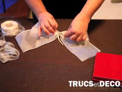 Comment faire un noeud en ruban ou tissu ? - Tutoriel par trucsetdeco.com